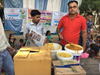 Serving Meal to slum children's_1